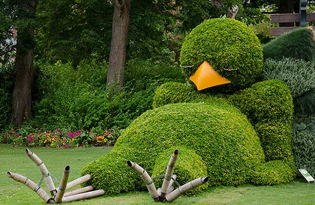 Giant Topiary Sleeping Chick In French Botanical Garden