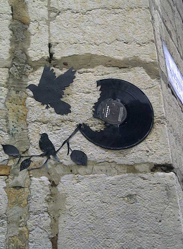 Vinyl Silhouettes Of Birds On The Streets Of Lyon, France Capture The Essence Of Freedom